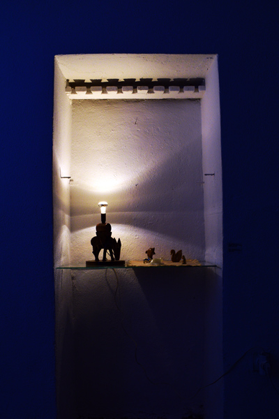 blue light alter with animal figures sculpture