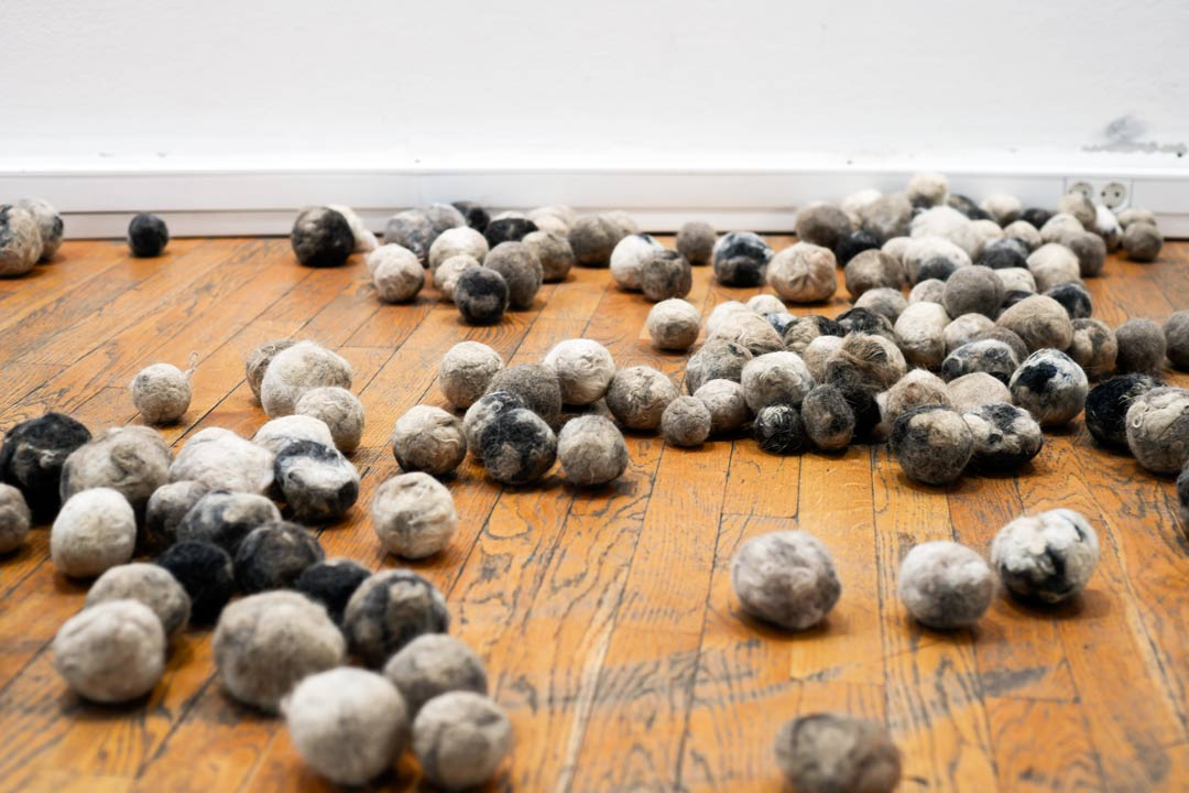 balls from dog hair in art gallery