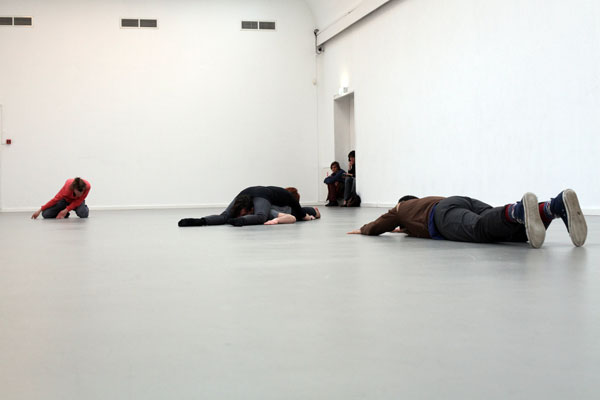 four bodies laying on floor