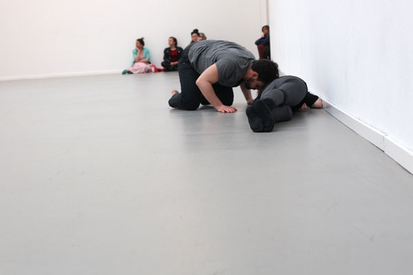 audience watching man pushing woman with his head