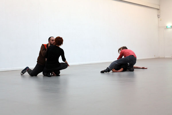 two couples moving on grey floor
