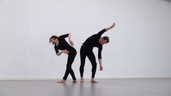 woman and man in black dancing