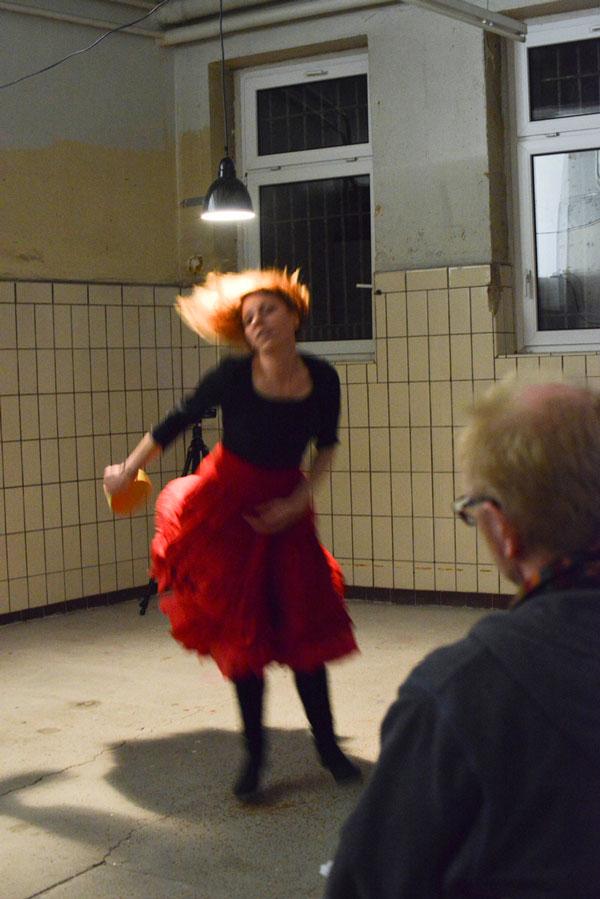 woman in red dress dancing