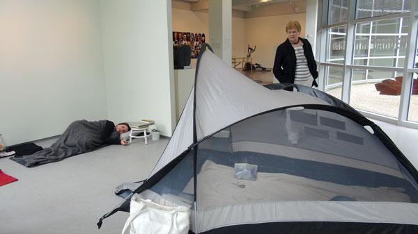 artist sleeping in museum