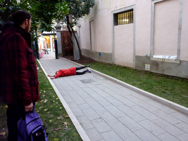 woman in red dress rolling down street